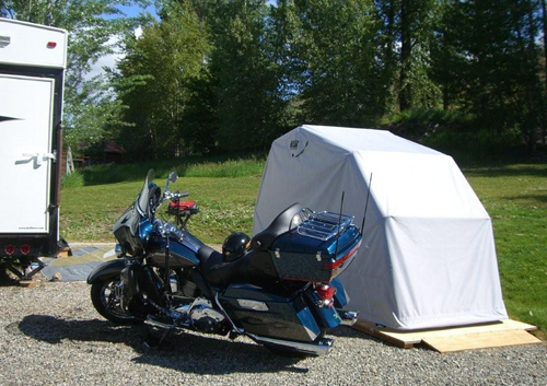 Ride in motorcycle cover on platform bike barn
